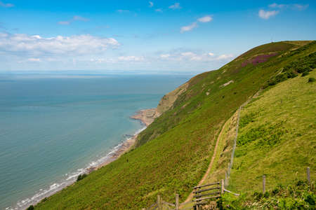 Coastline and ocean looking away from Lynmouth in North Devon, England