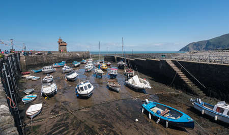 lynmouth: LYNMOUTH, DEVON UK – JULY 24:  Mud in harbor at low tide on 24 July 2017 in Ilfracombe, UK. The village was disastrously flooded in August 1952.