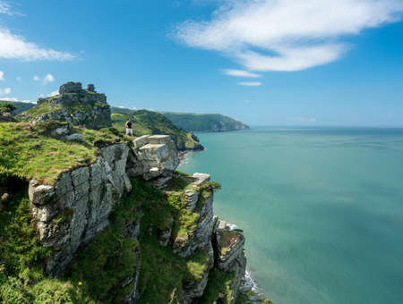 lynmouth: Hiker on the headland in Valley of the Rocks on South West coast path near Lynmouth