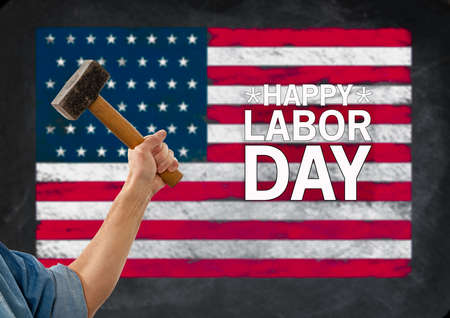 Hammer in arm of a construction worker in front of USA flag for Labor Day background poster