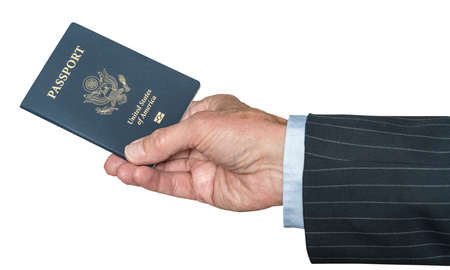 Isolated image of a senior man arm in suit and hand holding a USA passport Stock Photo