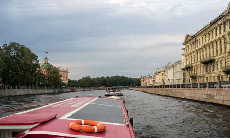 leningrad: ST PETERSBURG, RUSSIA - SEPTEMBER 12: Canal boat tour on September 12, 2017 in St Petersburg, Russia. There are 342 bridges in the city.