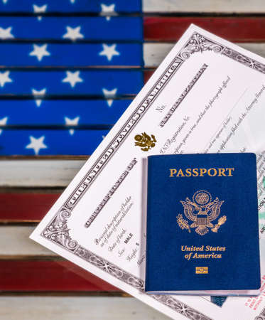 USA Passport And Naturalization Certificate Of Citizenship Over ...