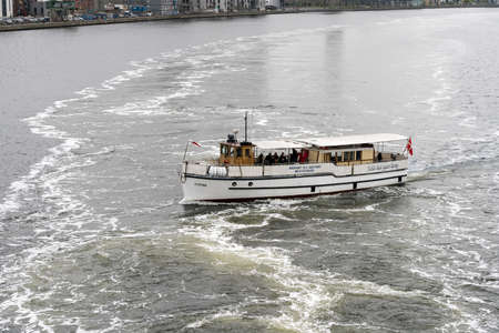 AALBORG, DENMARK - 19 SEPTEMBER: Tour boat MS Kysten on 19 September 2017 in Aalborg. The ship was built in 1940.