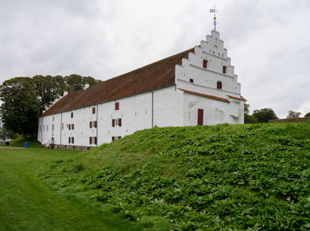 White exterior of Aalborghus Castle in the old town of Aalborg in Denmark