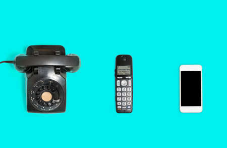 Three phones from rotary dial through wireless to modern smartphone