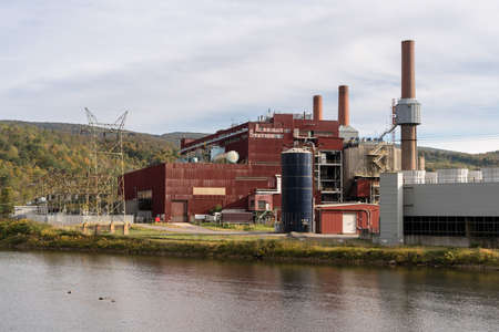 PRESTON COUNTY, WEST VIRGINIA - OCTOBER 14, 2017: Closed and shuttered Albright coal powered power station by banks of Cheat River
