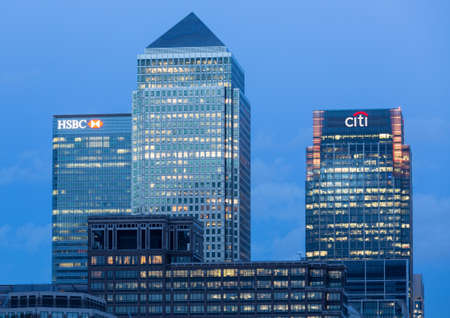 LONDON, UK - JANUARY 30, 2016: Skyline of the main office buildings at dusk from across the river at Canary Wharf, Docklands, London, England Editorial