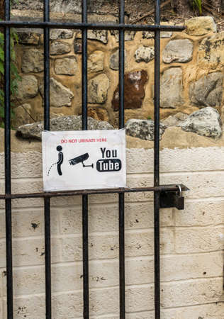 EASTBOURNE, UK - SEPTEMBER 19, 2016: Humorous sign to deter people from urinating in corner at Eastbourne, UK Editorial
