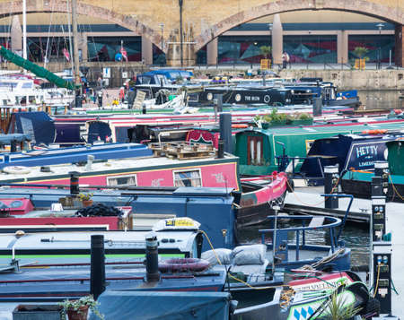 LONDON, UK - JANUARY 30, 2016: Crowded barges and houseboats in Limehouse Basin Marina in Docklands, London, England