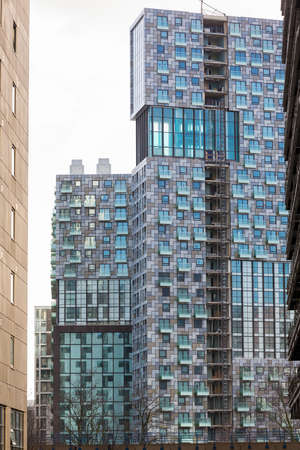 LONDON, UK - JANUARY 30, 2016: New apartment or residential tower in Canary Wharf, Docklands, London, England