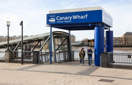 LONDON, UK - JANUARY 30, 2016: Thames Clippers ferry terminal on River Thames in Canary Wharf, Docklands, London, England