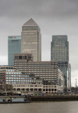 LONDON, UK - JANUARY 30, 2016: Skyline of the main office buildings on a cloudy foggy day suggesting a recession or financial crisis in Canary Wharf, Docklands, London, England Redakční