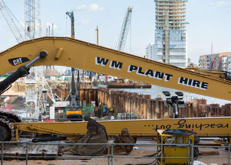 LONDON, UK - JANUARY 30, 2016: Cranes and building work in construction site for new building in Canary Wharf, Docklands, London, England