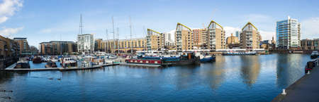 LONDON, UK - JANUARY 30, 2016: Panoramic photo of the apartment buildings and boats around Limehouse Basin Marina in Docklands, London, England Editorial