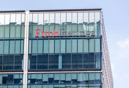 LONDON, UK - JANUARY 30, 2016: Logo or sign for Fitch Ratings Agency on side of office building in Canary Wharf, Docklands, London, England