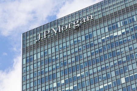 LONDON, UK - JANUARY 30, 2016: Logo or sign for JP Morgan Bank on side of office building in Canary Wharf, Docklands, London, England