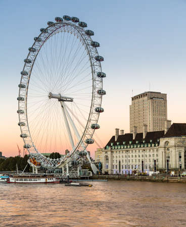 LLONDON, UK - OCTOBER 1, 2015: ondon Eye or Millenium Wheel on South Bank of River Thames in London England