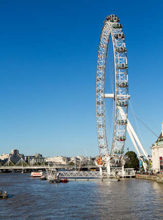 LONDON, UK - OCTOBER 1, 2015: London Eye or Coca Cola on South Bank of River Thames in London England