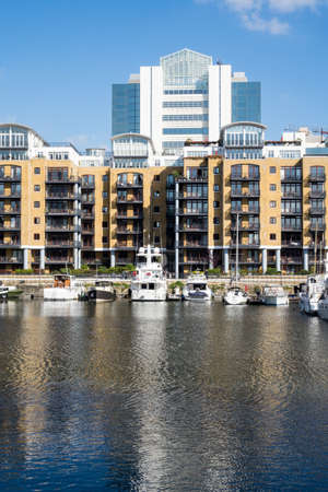 LONDON, UK - OCTOBER 1, 2015: View of the boats and barges in St Katherines Dock in London, England
