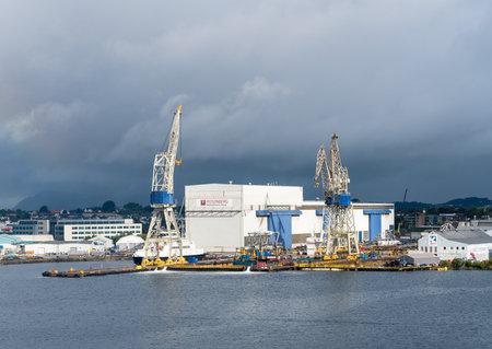 STAVANGER, NORWAY - SEPTEMBER 20, 2017: Oil rig construction company and shipyard Rosenberg in Stavanger Harbor. Editorial