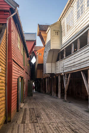 Narrow passageways between warehouses in Bryggen district in the center of Bergen, Norway