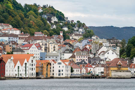 BERGEN, NORWAY - 22 SEPTEMBER, 2017: Houses and warehouses line the dockside in Bergen, Norway Stock Photo