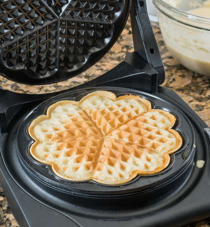 Norwegian heart shaped waffle maker on granite kitchen worktop