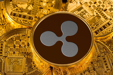 Illustration of ripple coin on gold background to illustrate blockchain and cyber currency