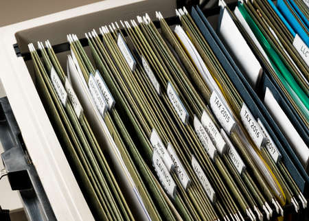 Close up of a well organized home filing system with tabs for each subject