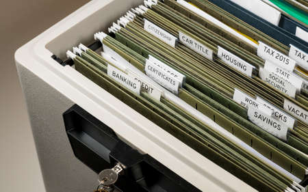 Close up of a well organized home filing system with tabs for each subject with focus on social security