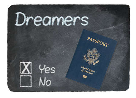 Dreamers Yes Vote message written in chalk on a chalky natural slate blackboard with Passport for Dreamers