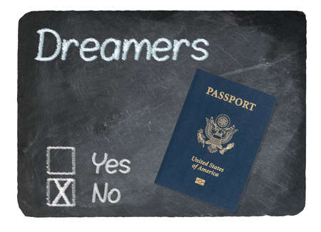 Dreamers No Vote message written in chalk on a chalky natural slate blackboard with Passport for Dreamers Stok Fotoğraf
