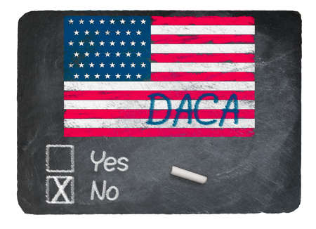DACA No Vote message written in chalk on a chalky natural slate blackboard for current debate over Dreamers