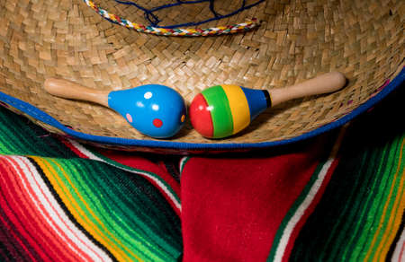 Cinco de Mayo background image on with maracas and sombrero on wooden rustic boards Stock Photo