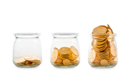 Three glass bottles with increasing amounts of gold coins to show how savings grow over time