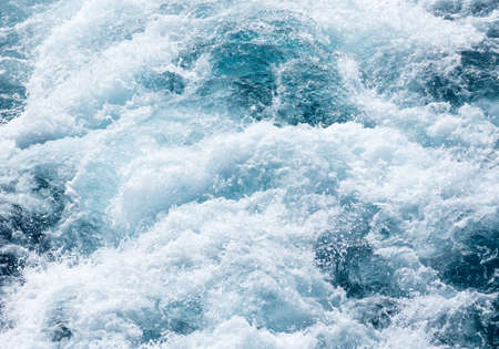 View down at the  powerful churning ocean behind a cruise ship at sea