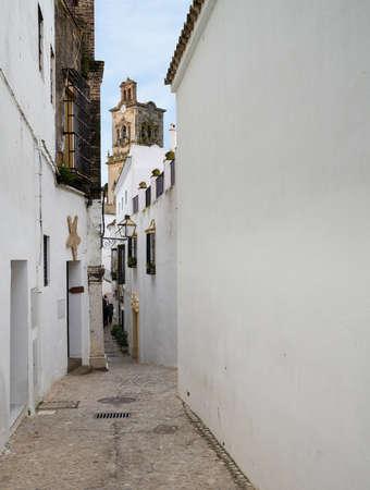 Narrow street in old town of Arcos de la Frontera near Cadiz in Spain