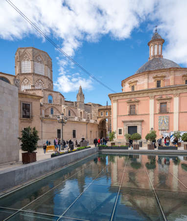 VALENCIA, SPAIN - MARCH 16, 2018: Cathedral and Basilica with reflection in Valencia in Spain