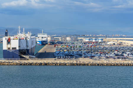 VALENCIA, SPAIN - MARCH 16, 2018: Many cars ready for export in the Neptune Horizon ship in Valencia Port Editorial
