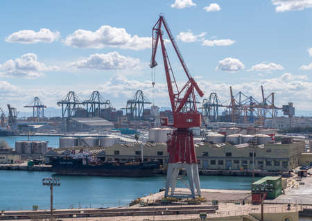 VALENCIA, SPAIN - MARCH 16, 2018: Older red painted crane on the dockside in Valencia Spain Editöryel