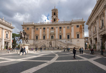 ROME, ITALY - MARCH 18, 2018: Tourists on the plaza in front of the City Hall in Rome, Italy