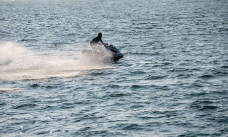 Waverunner or personal water craft in the ocean off Ilfracombe harbour in Devon Imagens