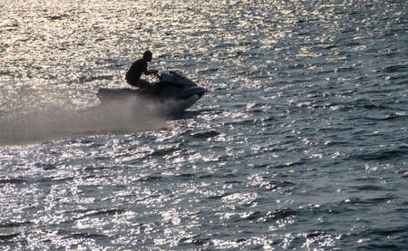 Waverunner or personal water craft in the ocean off Ilfracombe harbour in Devon Фото со стока