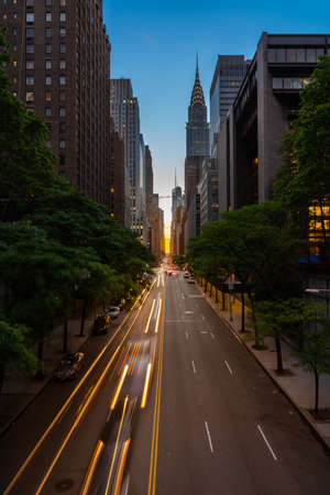 Sun setting along the length of 42nd street in New York city known as Manhattanhenge