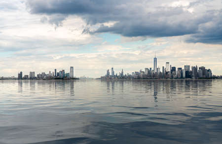 Panorama of Manhattan in NYC and Jersey City with artificial water showing reflections