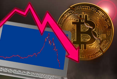Concept of bitcoin or cyber currency price crash with laptop with falling price graph