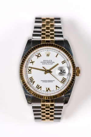 MORGANTOWN, WV - 24 JULY 2018: Mens Rolex Oyster Perpetual Datejust gold watch against white background Editorial