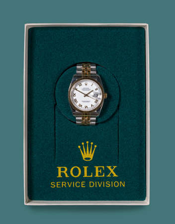 MORGANTOWN, WV - 23 JULY 2018: Mens Rolex gold watch in box returned from Service Division Editorial