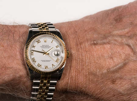 MORGANTOWN, WV - 24 JULY 2018: Rolex Oyster Perpetual Datejust gold watch on senior mans wrist